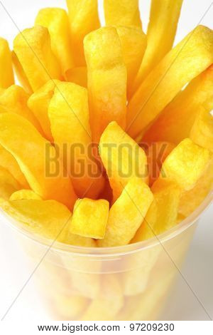 detail of french fries in plastic cup