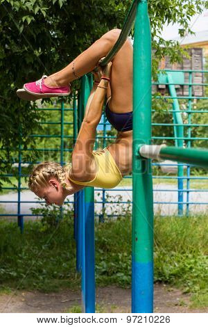 Young Beautiful Girl Pulled On The Bar