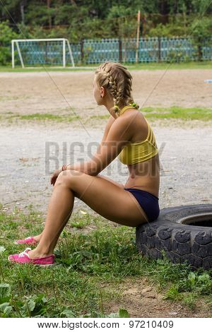 Young Beautiful Woman Resting After Workout