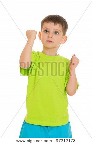 little boy showing his fists