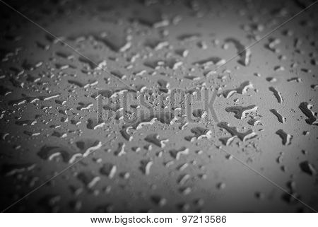 Water Drops On Black Surface