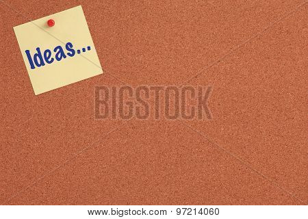Cork board with yellow note and Ideas text