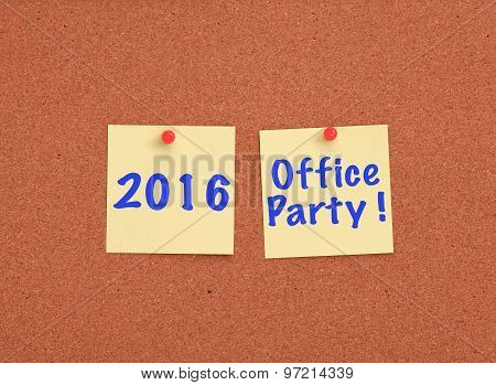 Cork board with 2016 office party written on two yellow notes