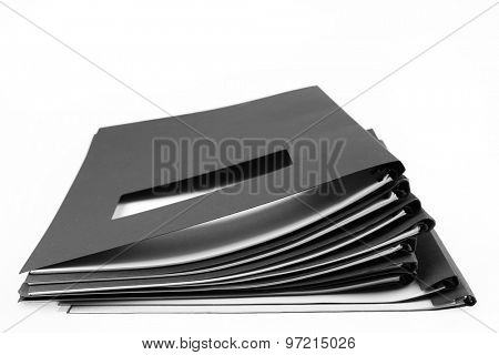 Pile of folders on plain background