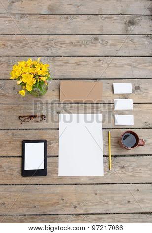 Template for photos, in Wooden floor is business cards, glasses, pencil, paper, flowers, tablet, cof