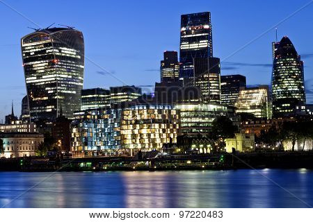 Night skyline of London famous modern glass skyscrapers in financial and insurance part of the with