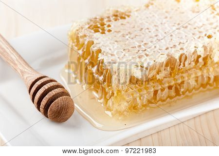Honey Comb On Wooden Table