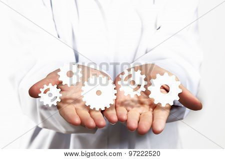 Gears in hands
