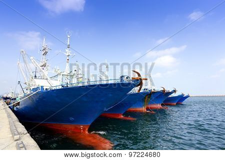 Row of ships docked at harbor