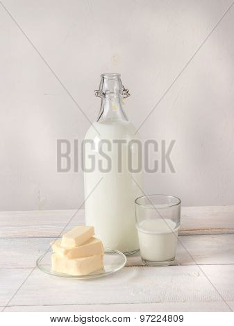 Dairy Products On White Wooden Table.