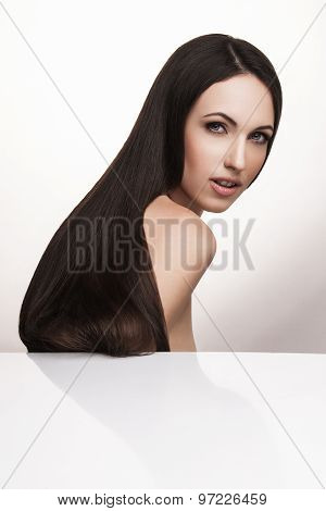 Elegant woman with long shiny hair