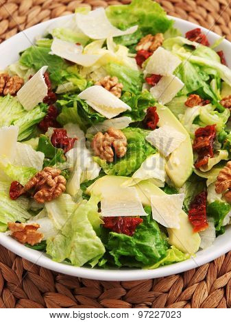Salad With Avocado, Dried Tomatos And Walnuts