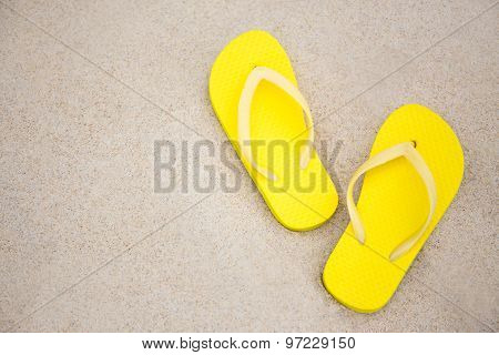 Close Up Of Flip Flops And Copy Space On Sandy Beach