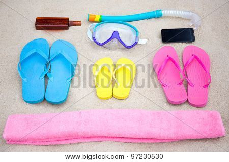Family Travel Concept - Summer Beach Accessories On The Sand