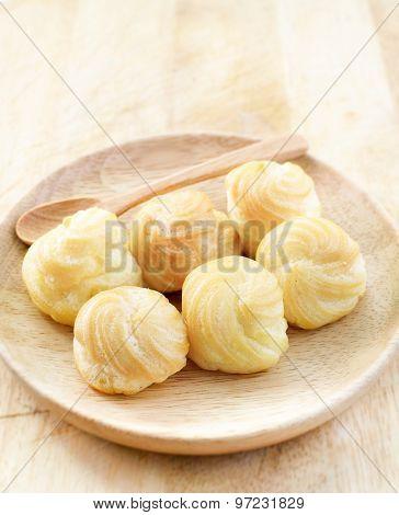 Choux Cream, Cream Puff On Wooden Table