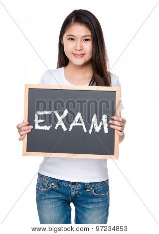Young woman hold with chalkboard and showing a word exam