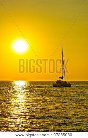 Catamaran Sailboat At Golden Sunset