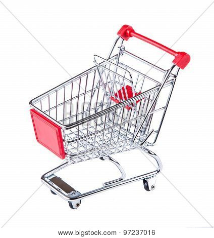 Shopping trolley isolated on white. The empty cart for purchases on the white