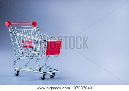 Shopping trolley. Shopping cart. Shopping trolley on muti collored background.