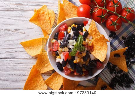 Mexican Salsa  With Beans And Corn Chips Nachos. Horizontal Top View