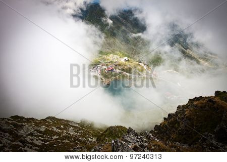 Balea Lake covered by fog, Fagaras Mountains, Romania in the summer