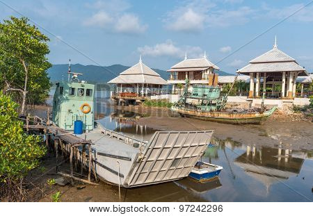 fishing boats and ferry moored on the coast in Fishing Village of the Koh Chang island,Thailand .