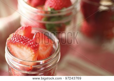 Strawberries in glass canning jars