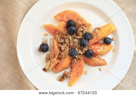 Fruit plate with blueberries and peaches