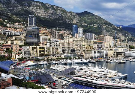 LA CONDAMINE, MONACO - MAY 16: Aerial view of the Port Hercules on May 16, 2015 in La Condamine, Monaco, during the preparations for the 73 Monaco Grand Prix, and Monte Carlo in the background