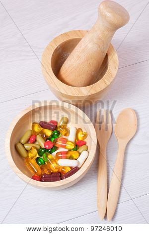 Medicine And Vitamin On Wooden Bowl