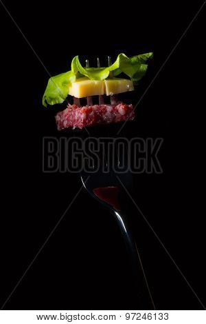 Salami, Cheese And Lettuce On A Fork