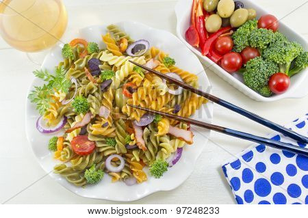 Pasta Meal Cooked With Vegetables With Fresh Vegetables Served With Chopsticks