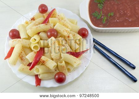 Macaroni With Cherry Tomatoes And Red Pepper Served With A Tomato Sauce In A White Bow For Eating Wi