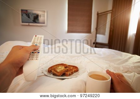 Point Of View Image Of Man In Bed Watching Television