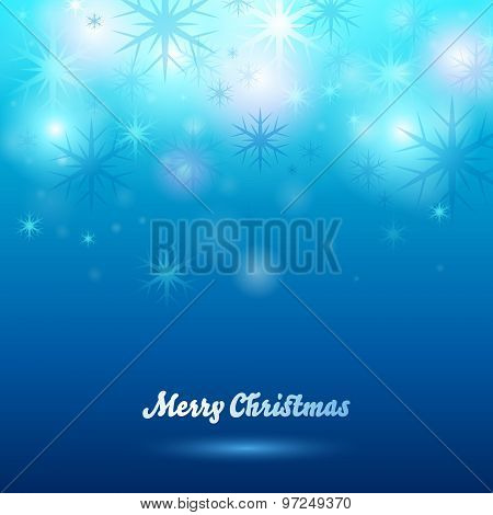 Glowing christmas background. Snowflakes on blue.