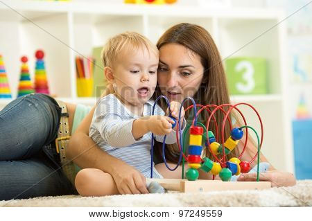 funny child playing with educational toy indoor