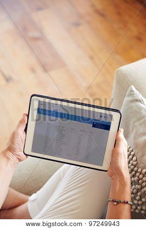 Woman Looking At Banking App On Digital Tablet