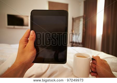 Point Of View Image Of Man In Bed Looking At Digital Tablet