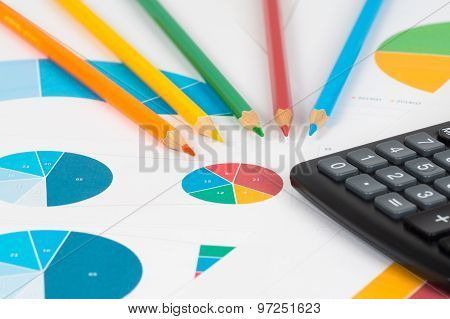 Pie And Bar Charts With Pencils And Calculator 3