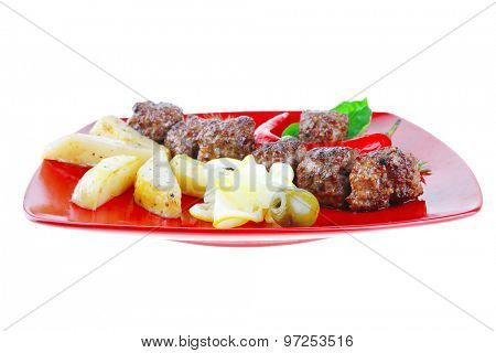 grilled meatballs with potatoes and peppers