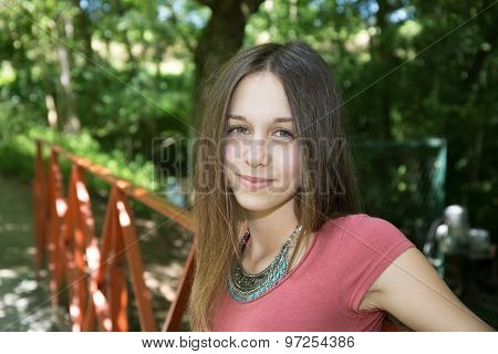 Pretty And Lovely Teenager  At The Park
