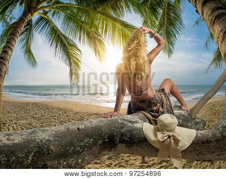 Woman relaxing at the tropical resort beach