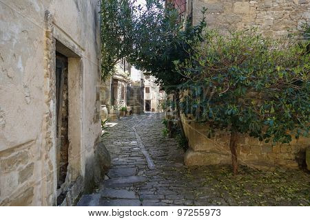 Old and small Istrian street in Groznjan, Croatia.