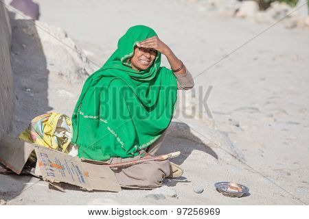 Poor Woman Begs For Money From A Passerby In Leh.  India