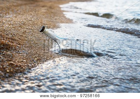 Sealed Bottle Near Sea