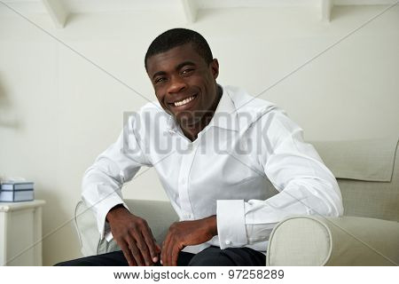 portrait of professional smart african black business man sitting at home