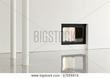 modern house, empty room with pillar and fireplace, white walls