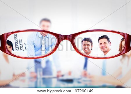 Glasses against business people in office at presentation