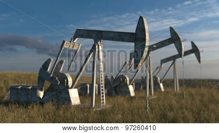 Oil wells - oil pumps on sky background