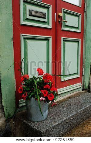 Door, Mailbox And A Bucket Of Flowers
